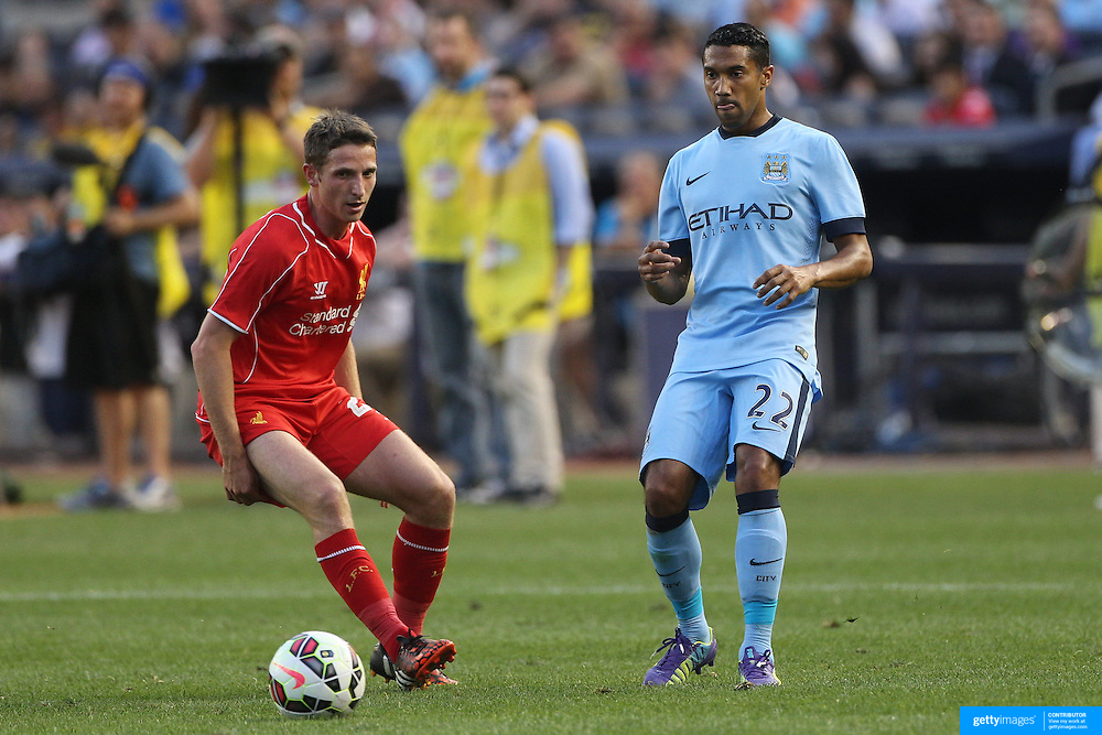 Gael Clichy, (right), Manchester City, challenged by Joe Allen, Liverpool,  during the Manchester City Vs Liverpool FC Guinness International Champions Cup match at Yankee Stadium, The Bronx, New York, USA. 30th July 2014. Photo Tim Clayton