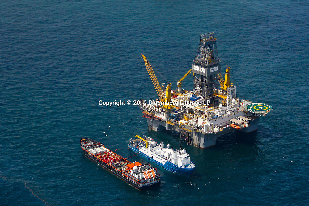 The Transocean Development Driller III rig drills a relief well at the BP Plc MC252 well site in the Gulf of Mexico off the coast of Louisiana, U.S., on Sunday, July 18, 2010. BP Plc said that a pressure test on its damaged Macondo well halted the flow of oil into the Gulf for the first time in three months. The oil spill, the biggest in U.S. history, had been spewing 35,000 to 60,000 barrels of oil a day since the drilling rig exploded on April 20. Photographer: Derick E. Hingle/Bloomberg