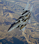 """K-9,""pilot and ""KEGI"" (in back seat), weapons officer operate an F-15E Strike Eagle over the mountains and high desert of Afghanistan in support of Operation Mountain Lion, 12 April 2006. The crew and fighter are deployed to the 336th Expeditionary Fighter Squadron, in Southwest Asia, from the 4th Fighter Wing at Seymour Johnson Air Force Base, NC. U.S. Air Force F-15s, A-10s and B-52s are providing close-air support to troops on the ground engaged in rooting out insurgent sanctuaries and support networks. Royal Air Force GR-7s also are providing close-air support to coalition troops in contact with enemy forces. U.S. Air Force Global Hawk and Predator aircraft are providing intelligence, surveillance and reconnaissance, while KC-135 and KC-10 aircraft are providing refueling support. (U.S. Air Force photo/Master Sgt. Lance Cheung)"