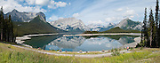 Upper Kananaskis Lake, on the Kananaskis Lakes Trail (highway), Peter Lougheed Provincial Park, Alberta. Upper Kananaskis Lake is a natural lake that was turned into a reservoir. Kananaskis Country is an improvement district (a type of rural municipal administrative unit) west of Calgary, Alberta, Canada in the foothills and front ranges of the Canadian Rockies. Panorama stitched from 5 images.