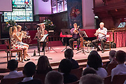 The BOLD AS Quintet comprises the leaders of the BOLD AS brass education project, Tim Hayward (trumpet), Letty Stott (French horn) and Phil White (trombone). They are joined for this school's workshop by Pete Smith (tuba) and Matilda Lloyd (trumpet). St. George's Church, Deal. © Tony Nandi