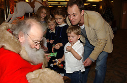 Actor JASON DONOVAN and his son ZAC meet Father Christmas at a children's party in aid of the charity Over The Wall held at Fortnum & Mason, Piccadilly, London before a gala premiere of the new musical Mary Poppins at The Prince of Wales Theatre, Old Compton Street, London W1<br />