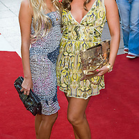 """London, Leicester Square  July 30th  Petra and Tamara Ecclestone arrive  at the uk film premiere of """"The X Files I want to believe"""" at the Empire Cinema in Leicester Square"""