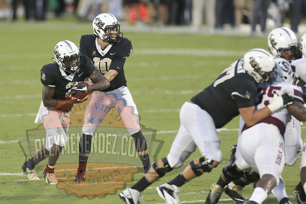 ORLANDO, FL - SEPTEMBER 08:  McKenzie Milton #10 of the UCF Knights hands the ball off to Otis Anderson #2 of the UCF Knights during a football game against the South Carolina State Bulldogs at Spectrum Stadium on September 8, 2018 in Orlando, Florida. (Photo by Alex Menendez/Getty Images) *** Local Caption *** McKenzie Milton; Otis Anderson