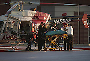 One of the burn victim children is loaded onto the stretcher at the helipad of the University of Utah Medical Center, Thursday, Nov. 15, 2012.