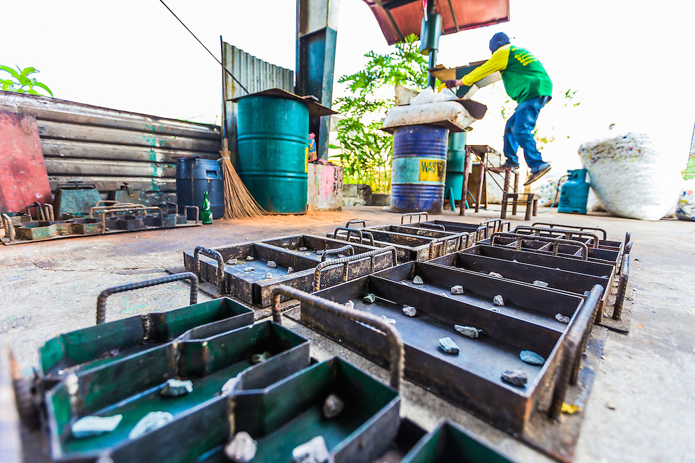 CAPTION: Plastics and polystyrene are collected and brought here, where they are melted at high temperatures and reshaped into small brick-like tiles. LOCATION: City Environmental Management Office, Marikina City, Philippines. INDIVIDUAL(S) PHOTOGRAPHED: N/A.