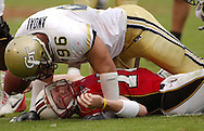 COLLEGE PARK, MARYLAND: GA Tech's JOE ANOAI  talks to MARYLAND'S  quarterback Joel Statham after sacking him  in the second quarter at the University of Maryland on Oct. 9, 2004. ©2004 Johnny Crawford
