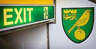 Club crest and exit signage in the stadium before the Barclays Premier League match between Norwich City and Arsenal at Carrow Road, Norwich<br /> Picture by Richard Calver/Focus Images Ltd +447792 981244<br /> 11/05/2014