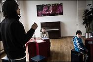 Professional rapper Marcelino van Callias teaches young students at the HipHop2 (quadrate) School in Arnhem in the Netherlands. At the Hip Hop school youngsters from 10 to 25 can take workshops in rap, hip hop, breakdance and DJ Spinning...In Arnhem is sinds januari 2006 een HipHopschool gevestigd. Op deze school kunnen jongeren van tussen de 10 en 25 jaar workshops volgen in Rap, R&B zang, Breakdance, HipHop dance en DJ Spinning. Dit iniatief is tot stand gekomen door een samenwerking van Stichting Interart en de Arnhemse Rapgroep ' Andere Gekte'.  Arnhem, NETHERLANDS - 15-2-06: