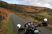 Motorcycle with GPS mounted on handlebars in Peak District National Park, Derbyshire