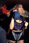 A woman dances at a club in Ibiza 2000's.