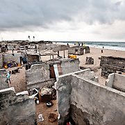 The fishing village of Totope, near Ada, Ghana, pictured on 9 March 2010, is disappearing as the encroaching sea and worsening coastal erosion bury villagers' homes in sand. Trapped between the sea and a lagoon, the village has nowhere to go.
