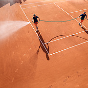 2017 French Open Tennis Tournament - Day Three.  Ground staff prepare court number two for it's next match in the late afternoon sunshine during the Men's Singles round one match at the 2017 French Open Tennis Tournament at Roland Garros on May 30th, 2017 in Paris, France.  (Photo by Tim Clayton/Corbis via Getty Images)