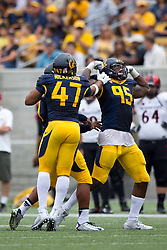 BERKELEY, CA - SEPTEMBER 12:  Defensive end DeVante Wilson #95 of the California Golden Bears celebrates after a play against the San Diego State Aztecs during the second quarter at California Memorial Stadium on September 12, 2015 in Berkeley, California. The California Golden Bears defeated the San Diego State Aztecs 35-7. (Photo by Jason O. Watson/Getty Images) *** Local Caption *** DeVante Wilson
