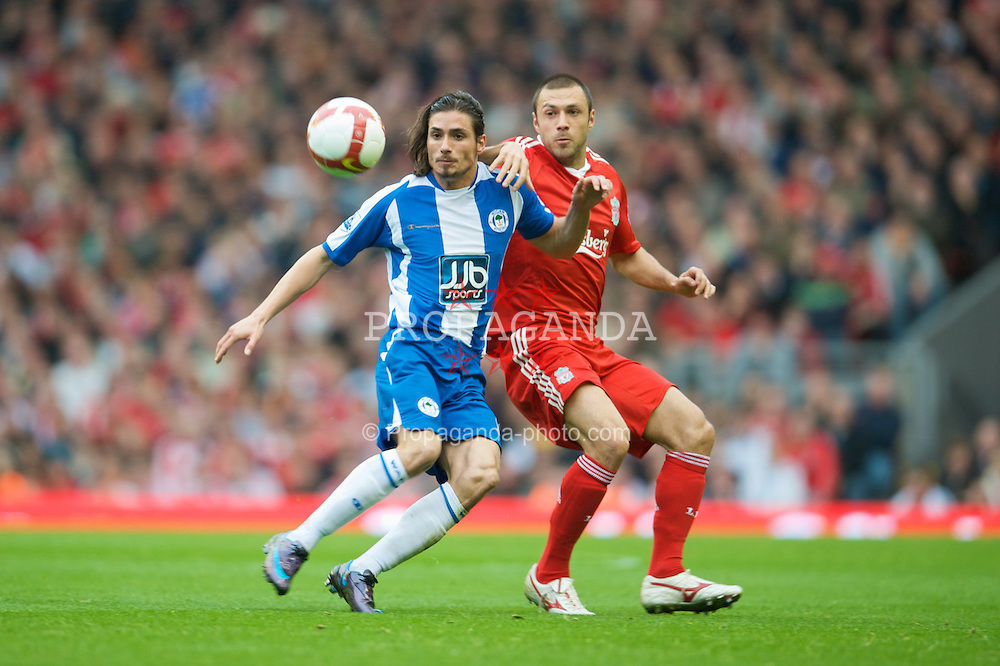 LIVERPOOL, ENGLAND - Saturday, October 18, 2008: Liverpool's Andrea Dossena and Wigan Athletic's Daniel De Ridder during the Premiership match at Anfield. (Photo by David Rawcliffe/Propaganda)