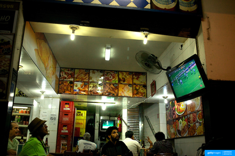 Locals watch the football at a bar in Copacabana Beach, Rio de Janeiro,  Brazil. 30th September 2010. Photo Tim Clayton