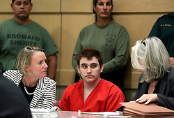 Nikolas Cruz speaks with his attorneys, public defenders Melisa McNeill, left, and Diane Cuddihy during a status check on his case at the Broward County Courthouse in Fort Lauderdale, FL, USA on Wednesday, August 15, 2018. Photo by Amy Beth Bennett/Sun Sentinel/TNS/ABACAPRESS.COM