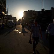 August 11, 2012 - Tarafat, Aleppo, Syria: Locals walk by the market area of Azaz.