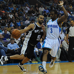 Jan 18, 2010; New Orleans, LA, USA; San Antonio Spurs guard Tony Parker (9) drives past New Orleans Hornets guard Chris Paul (3) during the first half at the New Orleans Arena. Mandatory Credit: Derick E. Hingle-US PRESSWIRE