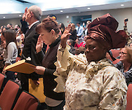 Goshen, New York - People raise their hands to take the Oath of Allegiance during a Naturalization ceremony at the Orange County Emergency Services Center on Nov. 17, 2016. A total of 86 people from 45 countries took the Oath of Allegiance and became citizens of the United States of America.