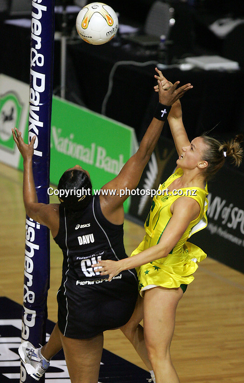 Sharelle McMahon gets the ball past Vilimaina Davu during the 2nd Netball International test match between the New Zealand Silver Ferns and Australia at Waitakere Stadium, Auckland, New Zealand on Saturday 14 October, 2006. The Silver Ferns won the match 43 - 37. Photo: Hannah Johnston/PHOTOSPORT<br />