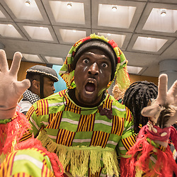Anteprima del nuovo Museo delle Culture - MUDEC a Milano <br /> Foto Piero Cruciatti / LaPresse<br /> 26-03-2015 Milano, Italia<br /> Cultura<br /> Danza totemica africana in cui il totem &egrave; la M di Mudec durante l&rsquo;anteprima del Museo delle Culture - MUDEC a Milano <br /> <br /> Preview of the new Museo delle Culture - MUDEC in Milano<br /> Photo Piero Cruciatti / LaPresse<br /> 26-03-2015 Milan, Italy<br /> Culture<br /> African dance performance during the new Museo delle Culture - MUDEC a Milano