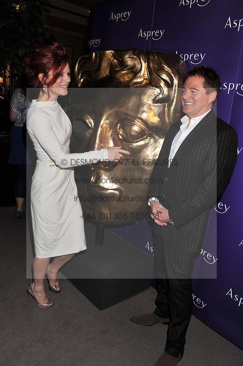 EMILIA FOX and CHARLES WORTHINGTON at the Asprey BAFTA Party held at Asprey, 167 New Bond Street, London on 11th February 2012.