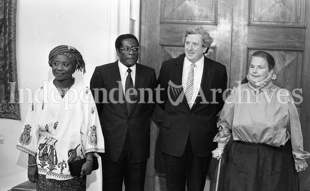 President of Zimbabwe Robert Mugabe, his wife Sally, former Taoiseach of Ireland Garrett Fitzgerald and his wife Joan at a State reception at Dublin Castle during Mugabe's three-day visit to Ireland in September 1983. (Part of the Independent Newspaperrs Ireland/NLI Collection)