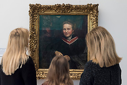 © Licensed to London News Pictures. 02/02/2018. LONDON, UK.  Staff members, joined by Stella Cartwright, aged 9, view a portrait of Millicent Fawcett, by Annie Swynnerton, on display at Tate Britain to mark the centenary of the women's right to vote, as embodied in the Representation of the People Act.  Millicent Fawcett was a leading figure in the suffragist movement, campaigning for the right for women to vote in the UK, while Annie Swynnerton was one of the first women elected to be a member of the Royal Academy of Arts.  Photo credit: Stephen Chung/LNP