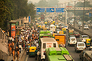India is the second most populated country in the world with almost a fifth of the world's population. Traffic and pedestrians pack the streets in New Delhi, India.