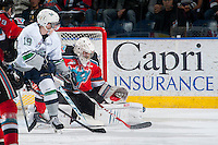 KELOWNA, CANADA - MARCH 18: Jackson Whistle #1 of Kelowna Rockets deflects a shot by the Seattle Thunderbirds on March 18, 2015 at Prospera Place in Kelowna, British Columbia, Canada.  (Photo by Marissa Baecker/Shoot the Breeze)  *** Local Caption *** Jackson Whistle;
