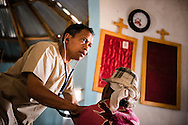 Dr. Sahalanirina Harison Rasamimanana examines a patient during the Mercy Medical Team clinic on Saturday, Oct. 18, 2014, at a Fiangonana Loterana Malagasy (FLM) Lutheran church in Antsoantany, Madagascar. LCMS Communications/Erik M. Lunsford