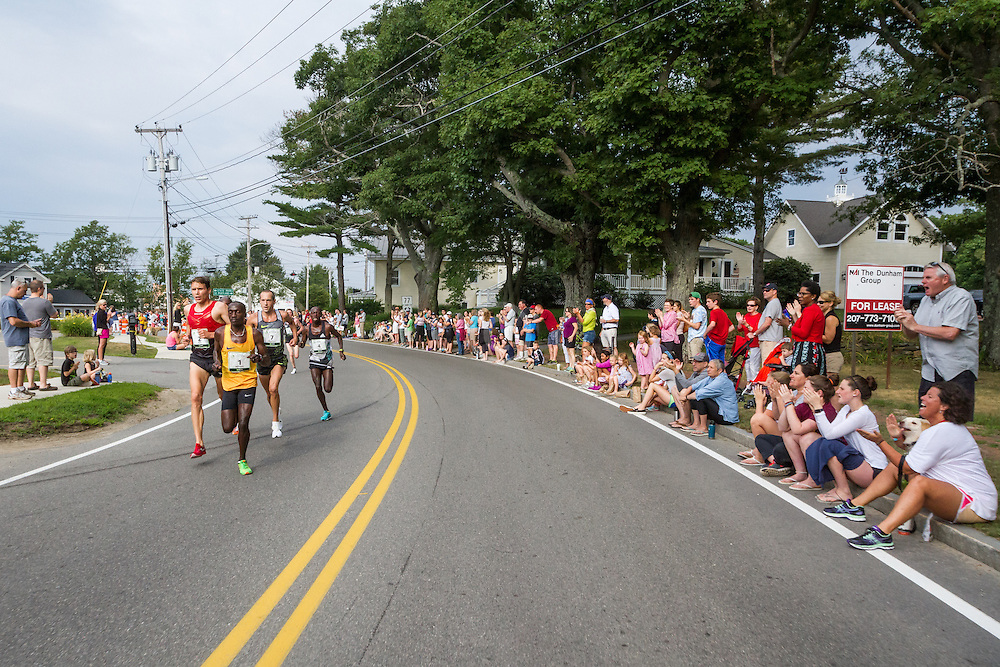 Ben True and William Stitonik battle as they turn onto Shore Road at halfway point of race