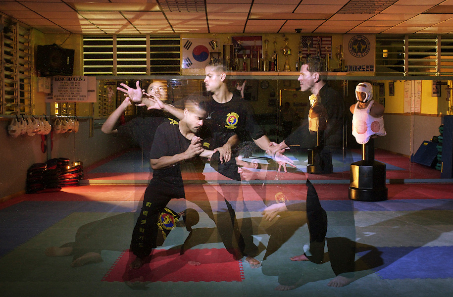 Staff Sgt. David Rivas, a recruiter in San Juan, Puerto Rico, is also a black belt in Hapkido.  This martial art uses speed against force to break free and subdue Staff Sgt. Jorge Hernandez (left) and Angel Jimenez (right), during a practice attack.