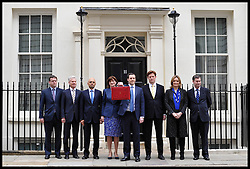The Chancellor of the Exchequer George Osborne holding the budget box stands with his Treasury team (L-R) Parliamentary Private Secretary to George Osborne Rob Wilson, Commercial Secretary to the Treasury Lord Deighton, Financial Secretary to the Treasury Sajid Javid, Economic Secretary to the Treasury Nicky Morgan, Chief Secretary to the Treasury Danny Alexander, Assistant Whip to the Treasury Amber Rudd and Exchequer Secretary to the Treasury David Gauke  poses on the steps of No11 Downing street with his red budget box for the 2014 Budget, London, United Kingdom. Wednesday, 19th March 2014. Picture by Andrew Parsons / i-Images.<br /> File Photo - SAJID JAVID announced as new UK culture secretary following resignation of Maria Miller. Photo filed Wednesday Apr 09 2014.