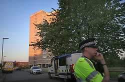 Police at the scene after they raided a block of flats (rear) in Blackley, north Manchester, following the attack on Manchester Arena where a suicide bomber killed 22 people leaving a pop concert at the venue on Monday night.