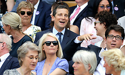Bear Grylls (top centre), Kitty McIntyre and Michael McIntyre in the royal box on centre court on day eleven of the Wimbledon Championships at the All England Lawn Tennis and Croquet Club, Wimbledon.