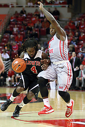 10 November 2014:  Gabe Williams storms the lane protected by Bobby Hunter during an exhibition men's basketball game between Lewis University Flyers and the Illinois State Redbirds at Redbird Arena, Normal IL