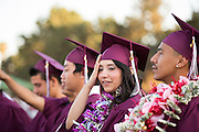 Cal Hills High School senior Gianna Hernandez holds her head is disbelief before receiving her diploma during the Class of 2013 graduation at the Milpitas Sports Center in Milpitas, California, on June 6, 2013. (Stan Olszewski/SOSKIphoto)