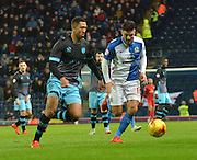 Sheffield Wednesday Defender, Liam Palmer and Blackburn Rovers Midfielder, Craig Conway chase for a loose ball during the Sky Bet Championship match between Blackburn Rovers and Sheffield Wednesday at Ewood Park, Blackburn, England on 28 November 2015. Photo by Mark Pollitt.