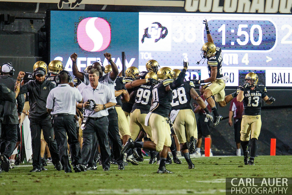 September 7th, 2013 - The Colorado Buffaloes celebrate a late fourth quarter interception that would seal their 38-24 victory over the University of Central Arkansas Bears in the NCAA football game at Folsom Field in Boulder, CO