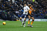Hull city Striker Chuba Akpom and Preston North End Defender Bailey Wright battle during the Sky Bet Championship match between Preston North End and Hull City at Deepdale, Preston, England on 28 December 2015. Photo by Pete Burns.