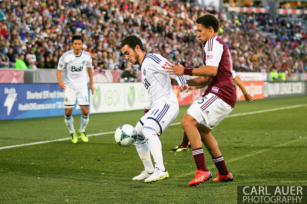 October 19th, 2013:  Vancouver Whitecaps FC midfielder Russell Teibert (31) shields the ball from Colorado Rapids defender Chris Klute (15) in the second half of the MLS Soccer Match between the Vancouver Whitecaps FC and the Colorado Rapids at Dick's Sporting Goods Park in Commerce City, Colorado