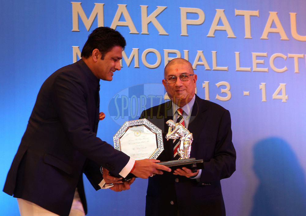 N Srinivathsan presents Anil Kumble with a moment of the occassionduring the 2nd Mansoor Ali Khan Pataudi Memorial Lecture held at the Taj Palace Hotel in Mumbai, India on the 13th November 2013<br /> <br /> Photo by: Ron Gaunt - BCCI - SPORTZPICS