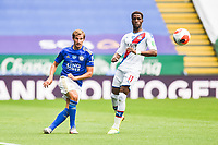 LEICESTER, ENGLAND - JULY 04: Marc Albrighton of Leicester City sends a ball down the wing ahead of Wilfried Zaha of Crystal Palace during the Premier League match between Leicester City and Crystal Palace at The King Power Stadium on July 4, 2020 in Leicester, United Kingdom. Football Stadiums around Europe remain empty due to the Coronavirus Pandemic as Government social distancing laws prohibit fans inside venues resulting in all fixtures being played behind closed doors. (Photo by MB Media)