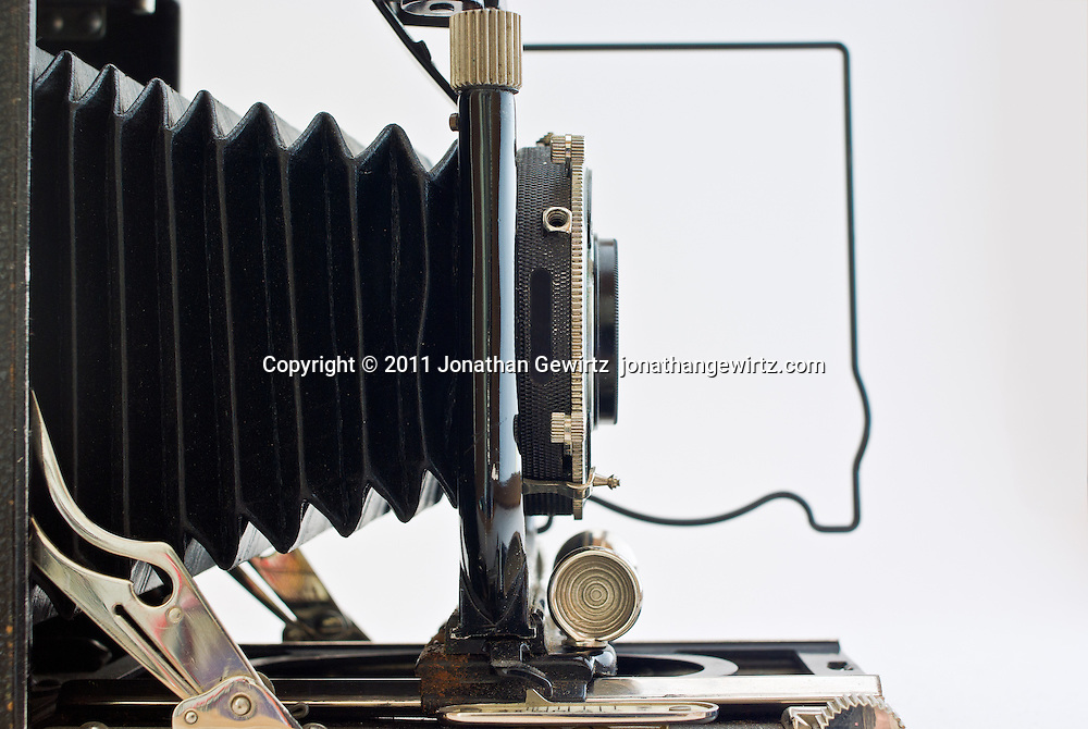 Side view of the bellows, lens and focusing rack of a 1920s Voigtlander Avus camera isolated on a white background. WATERMARKS WILL NOT APPEAR ON PRINTS OR LICENSED IMAGES.