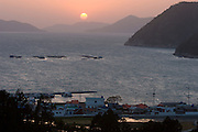 Geojedo (Geoje Island), Hallyeo Maritime National Park. Sunset near Jeogu. Oyster farms.