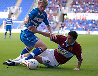 Photo: Daniel Hambury.<br /> Reading v Burnley. Coca Cola Championship.<br /> 29/08/2005.<br /> Reading's Kevin Doyle is tackled by Burnley's Michael Duff.