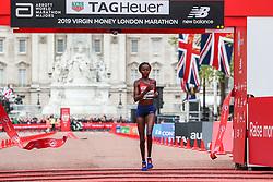 Brigid Kosgei of Kenya wins London Marathon in 2:18:20