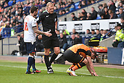 Hull City Midfielder,  Shaun Maloney  is fouled by Bolton Wanderers Midfielder, Mark Davies during the Sky Bet Championship match between Bolton Wanderers and Hull City at the Macron Stadium, Bolton, England on 30 April 2016. Photo by Mark Pollitt.